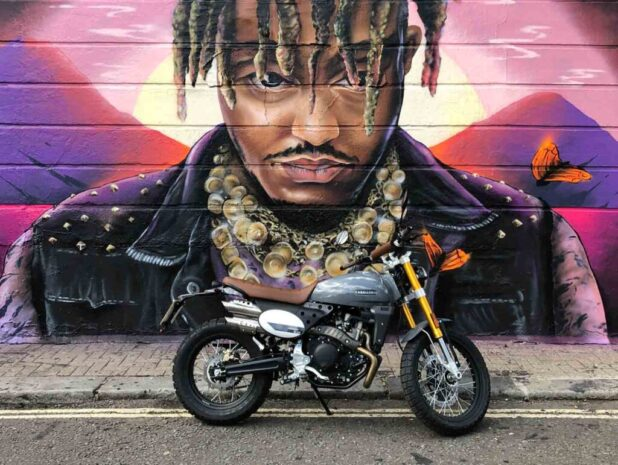 Caballero Scrambler Deluxe motorcycle in front of graffiti in Camden Town